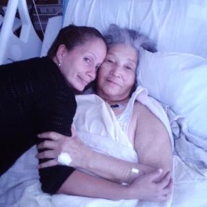 November 2014 - Staff member Elena Soto comforting Elvia at the hospital.