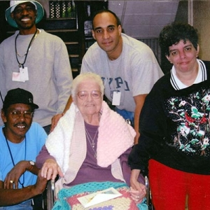 Robert Merced with two of the residents and two staff members.