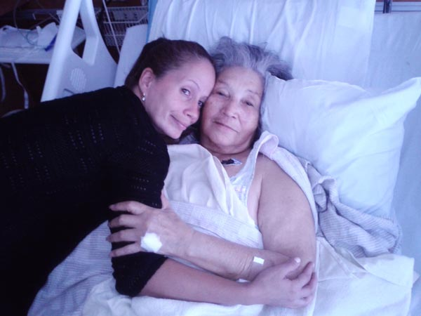 November 2014 - Staff member Elena Soto comforting Elvia at the hospital.